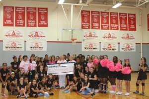 Sugar Land Middle School volleyball team, cheerleaders, and coaches present a check to FBJSL President-Elect Laura Taylor for the FBJSL Breast Cancer Fund.
