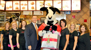 (Left to Right) Chasity Munn, SPM Board Liaison; Alison Haralson, SPM Co-Chair; Sherri Ebarb, SPM Co-Chair; Brent Kubala, Owner, Chick-fil-A Sugar Land; the Chick-fil-A cow; Catherine Kubala, SPM Co-Chair; Stephanie Van Horn, SPM Concessions Committee; and Cindy Reaves, SPM Concessions Committee.