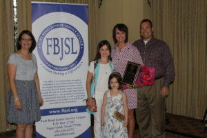 Left to Right: Dana Clement, 2015-2016 FBJSL President; Catherine Kubala, 2015-2016 Volunteer of the Year, and her family.